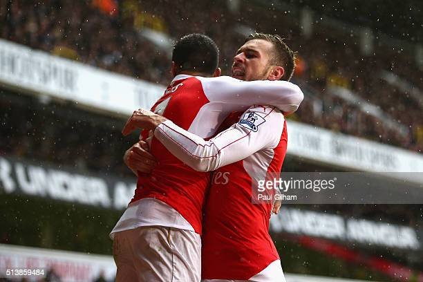 Alexis Sanchez of Arsenal celebrates scoring his team's second goal with his team mate Aaron Ramsey during the Barclays Premier League match between...