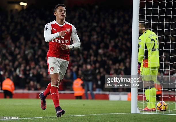 Alexis Sanchez of Arsenal celebrates scoring his team's third goal during the Premier League match between Arsenal and AFC Bournemouth at Emirates...