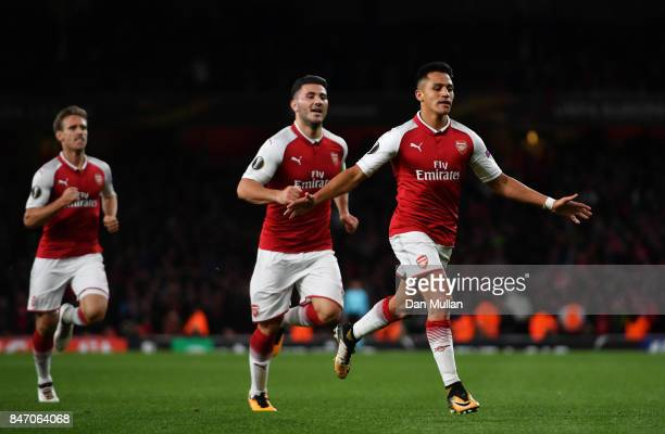 Alexis Sanchez of Arsenal celebrates scoring the 2nd arsenal goal with Sead Kolasinac of Arsenal during the UEFA Europa League group H match between...