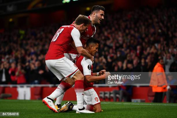 Alexis Sanchez of Arsenal celebrates scoring the 2nd arsenal goal with Sead Kolasinac of Arsenal and Nacho Monreal of Arsenal during the UEFA Europa...