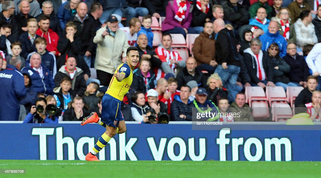 Alexis Sanchez of Arsenal celebrates scoring the first goal during the Barclays Premier League match between Sunderland AFC and Arsenal FC at The Stadium of Light on October 25, 2014 in Sunderland, England.