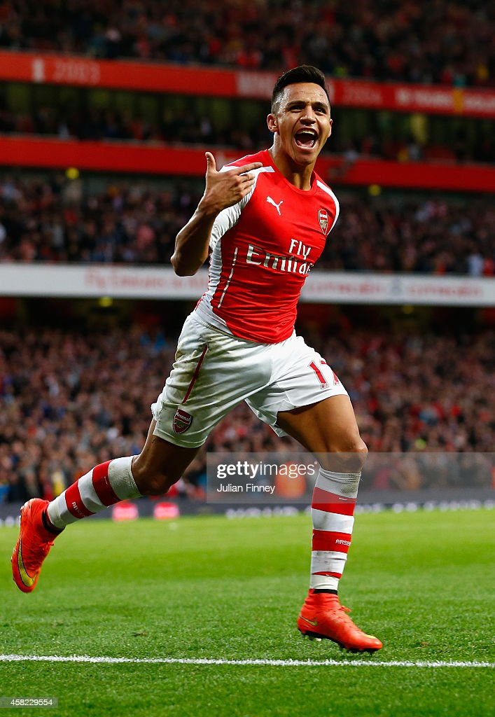 Alexis Sanchez of Arsenal celebrates scoring the first goal during the Barclays Premier League match between Arsenal and Burnley at Emirates Stadium on November 1, 2014 in London, England.