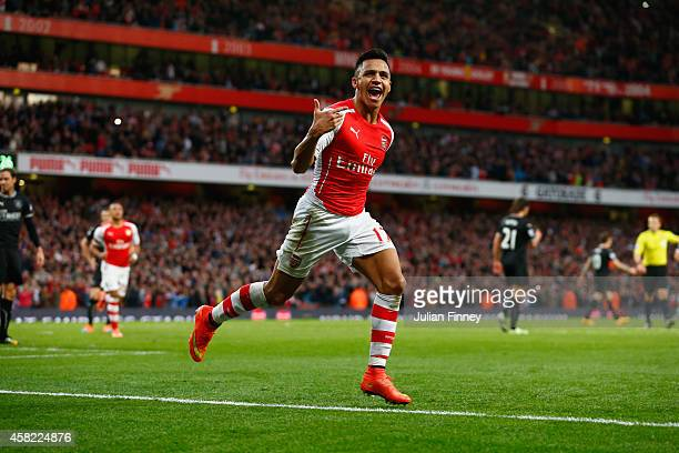 Alexis Sanchez of Arsenal celebrates scoring the first goal for Arsenal during the Barclays Premier League match between Arsenal and Burnley at...
