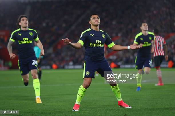 Alexis Sanchez of Arsenal celebrates scoring the opening goal during the Premier League match between Southampton and Arsenal at St Mary's Stadium on...