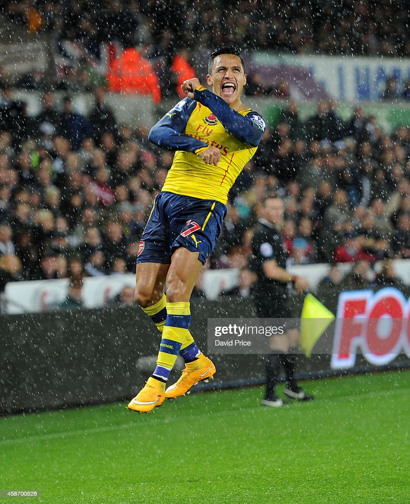 Alexis Sanchez of Arsenal celebrates scoring their goal during the Barclays Premier League match between Swansea and Arsenal at Liberty Stadium on November 9, 2014 in Swansea, Wales.