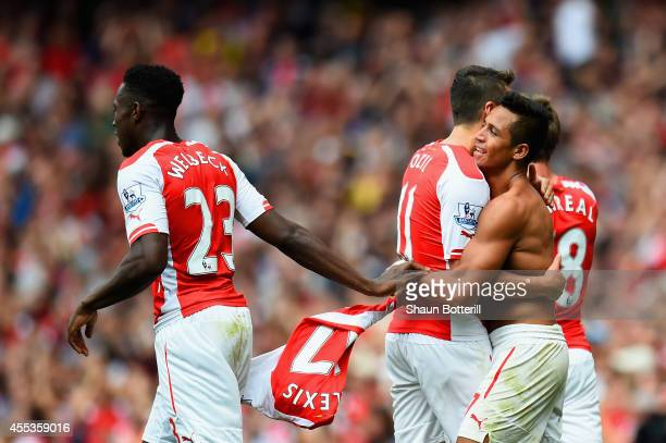 Alexis Sanchez of Arsenal celebrates scoring their second goal with Mesut Oezil and Danny Welbeck of Arsenal during the Barclays Premier League match...