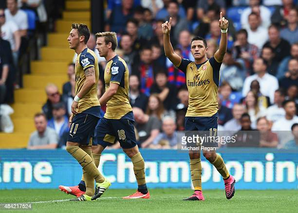 Alexis Sanchez of Arsenal celebrates the own goal scored by Damien Delaney of Crystal Palace during the Barclays Premier League match between Crystal...
