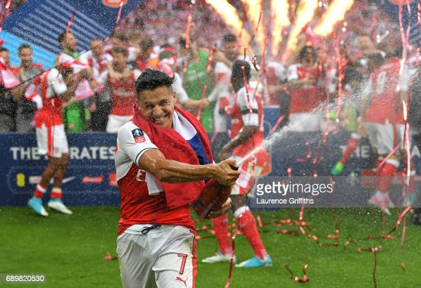 Alexis Sanchez of Arsenal celebrates victory after the Emirates FA Cup Final between Arsenal and Chelsea at Wembley Stadium on May 27, 2017 in...