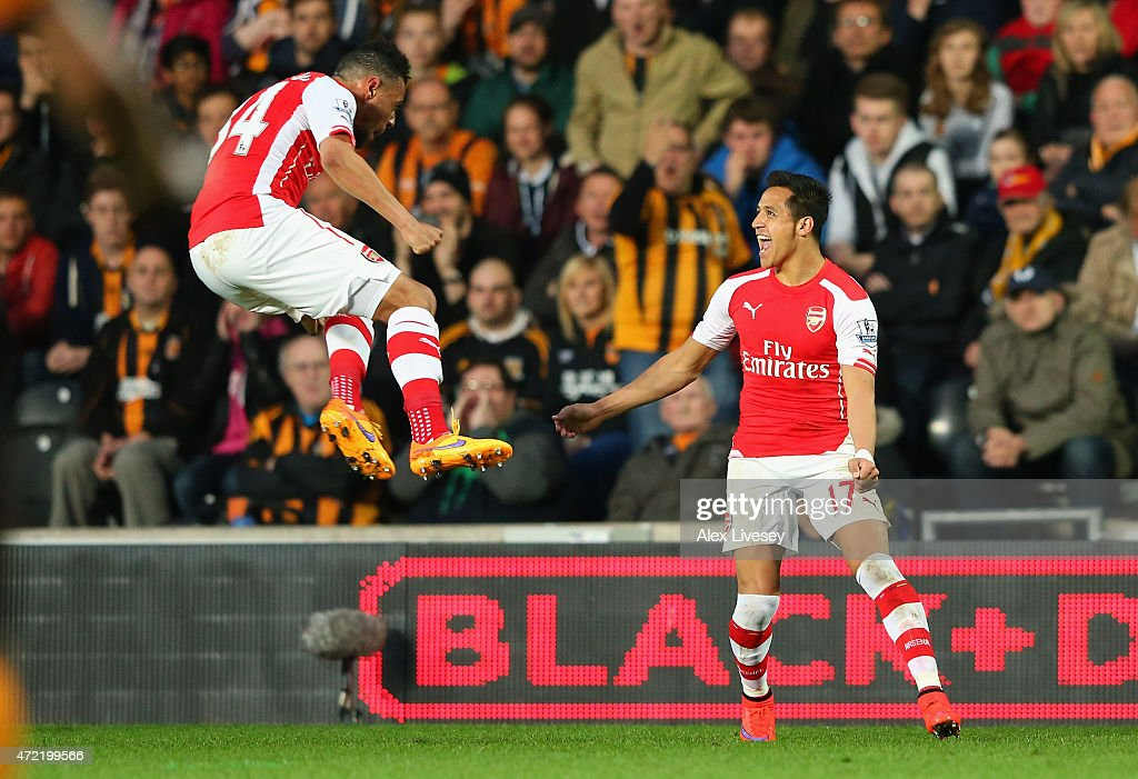 Alexis Sanchez of Arsenal (R) celebrates with Francis Coquelin after scoring their first goal during the Barclays Premier League match between Hull City and Arsenal at the KC Stadium on May 4, 2015 in Hull, England.