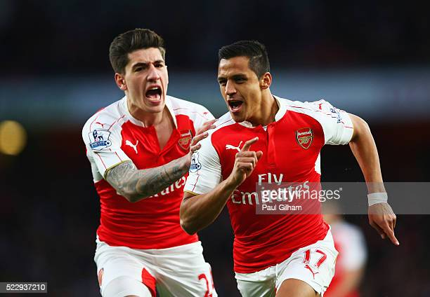 Alexis Sanchez of Arsenal celebrates with Hector Bellerin as he scores their first goal during the Barclays Premier League match between Arsenal and...