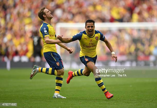 Alexis Sanchez of Arsenal celebrates with his team-mate Nacho Monreal after scoring their second goal during the FA Cup Final between Aston Villa and...