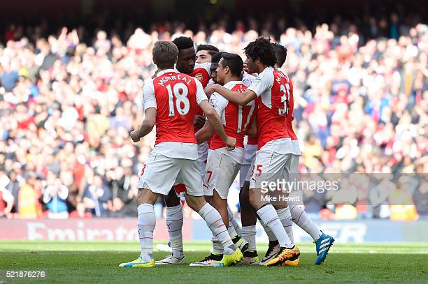 Alexis Sanchez of Arsenal celebrates with team mates after scoring the opening goal of the game during the Barclays Premier League match between...