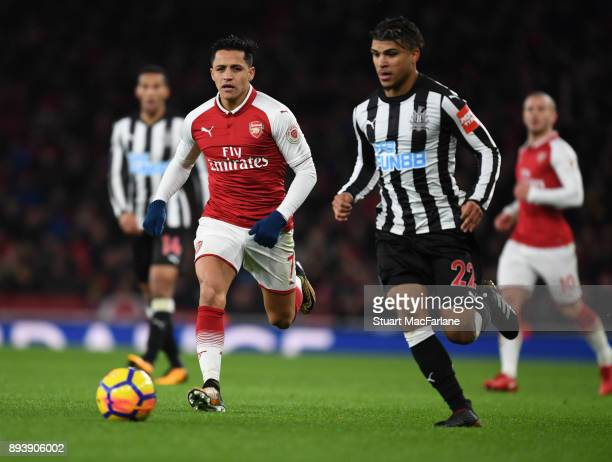 Alexis Sanchez of Arsenal challengd by DeAndre Yedlin of Newcastle during the Premier League match between Arsenal and Newcastle United at Emirates...