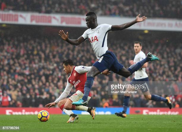 Alexis Sanchez of Arsenal challenged by Davinson Sanchez of Tottenham during the Premier League match between Arsenal and Tottenham Hotspur at...