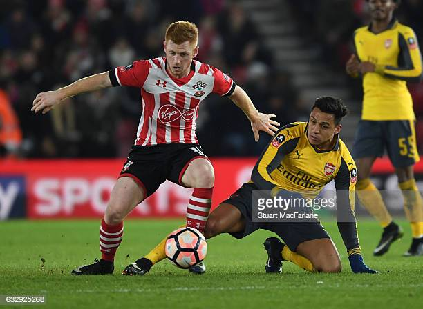 Alexis Sanchez of Arsenal challenges Harrison Reed of Southampton during the Emirates FA Cup Fourth Round match between Southampton and Arsenal at St...
