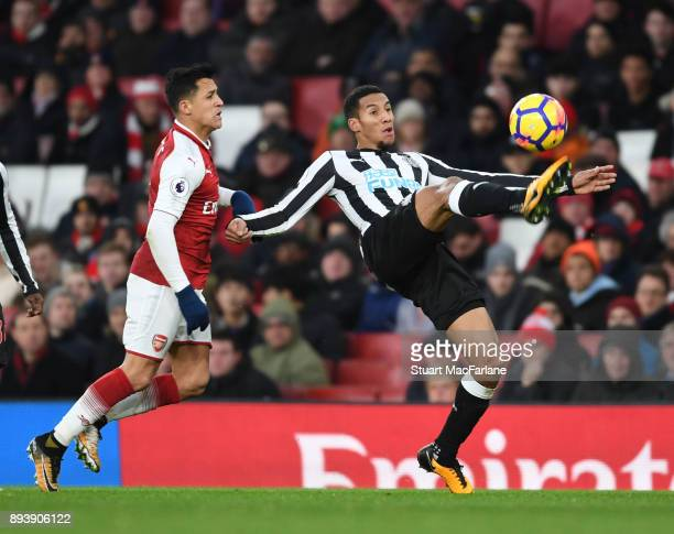 Alexis Sanchez of Arsenal challenges Issac Hayden of Newcastle during the Premier League match between Arsenal and Newcastle United at Emirates...