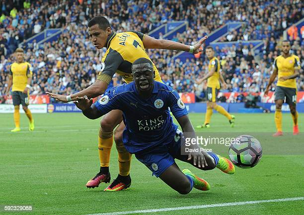 Alexis Sanchez of Arsenal challenges Nampalys Mendy of Leicester during the Premier League match between Leicester City and Arsenal at The King Power...