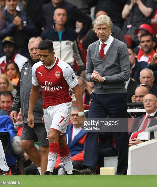 Alexis Sanchez of Arsenal comes on as a sub as Arsene Wenger the Arsenal manager looks on during the Premier League match between Arsenal and AFC...