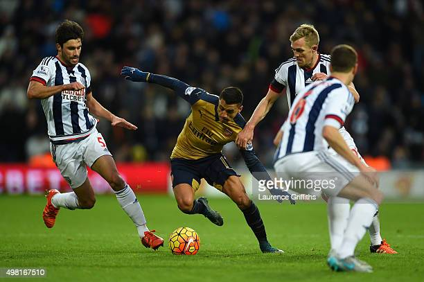 Alexis Sanchez of Arsenal competes for the ball against Claudio Yacob and Darren Fletcher of West Bromwich Albion during the Barclays Premier League...