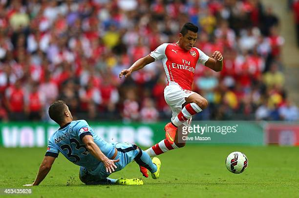 Alexis Sanchez of Arsenal competes for the ball with Matija Nastasic of Manchester City during the FA Community Shield match Manchester City and...