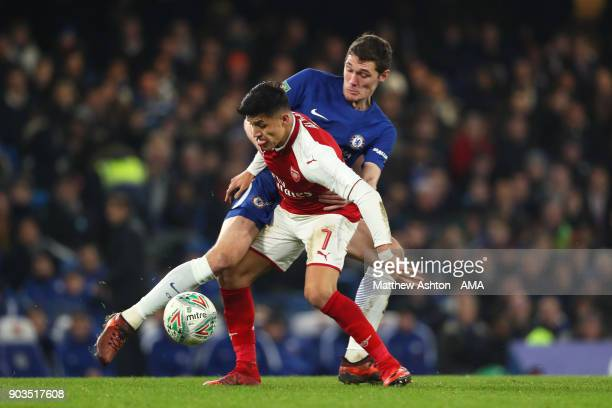 Alexis Sanchez of Arsenal competes with Andreas Christensen of Chelsea during the Carabao Cup SemiFinal first leg match between Chelsea and Arsenal...