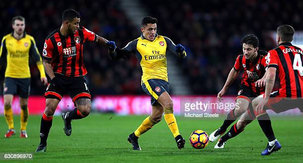 Alexis Sanchez of Arsenal controls the ball against AFC Bournemouth defense during the Premier League match between AFC Bournemouth and Arsenal at...