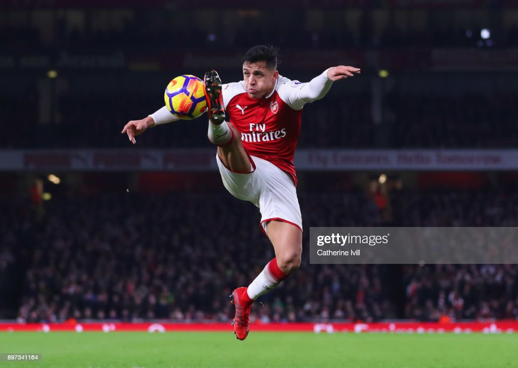 Alexis Sanchez of Arsenal controls the ball during the Premier League match between Arsenal and Liverpool at Emirates Stadium on December 22, 2017 in London, England.