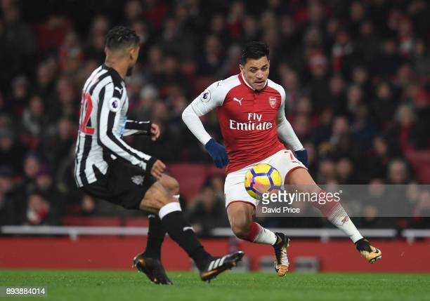 Alexis Sanchez of Arsenal controls the ball under pressure DeAndre Yedlin of Newcastle during the Premier League match between Arsenal and Newcastle...
