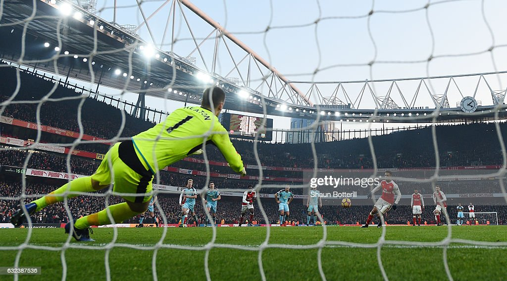 Alexis Sanchez of Arsenal converts the penalty to score his side's second goal during the Premier League match between Arsenal and Burnley at the Emirates Stadium on January 22, 2017 in London, England.