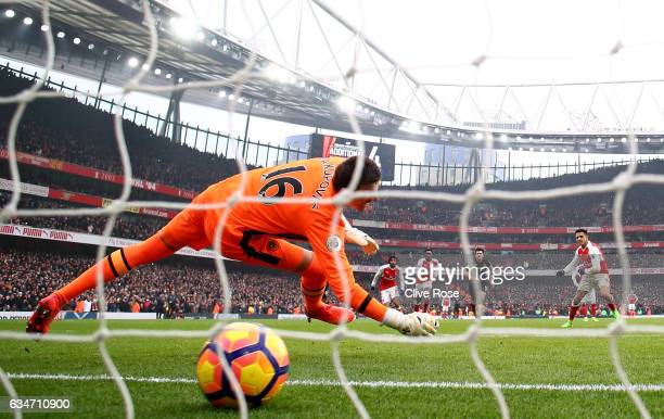 Alexis Sanchez of Arsenal converts the penalty to score his side's second goal past Eldin Jakupovic of Hull City during the Premier League match...