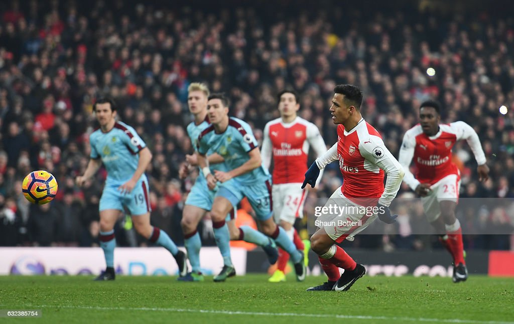 Alexis Sanchez of Arsenal converts the penalty to score his team's second goal during the Premier League match between Arsenal and Burnley at the Emirates Stadium on January 22, 2017 in London, England.