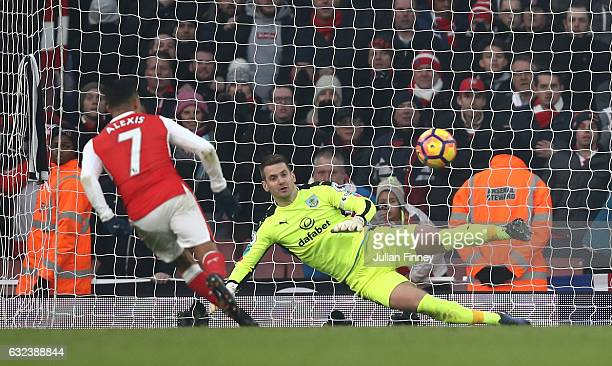 Alexis Sanchez of Arsenal converts the penalty to score his team's second goal during the Premier League match between Arsenal and Burnley at the...