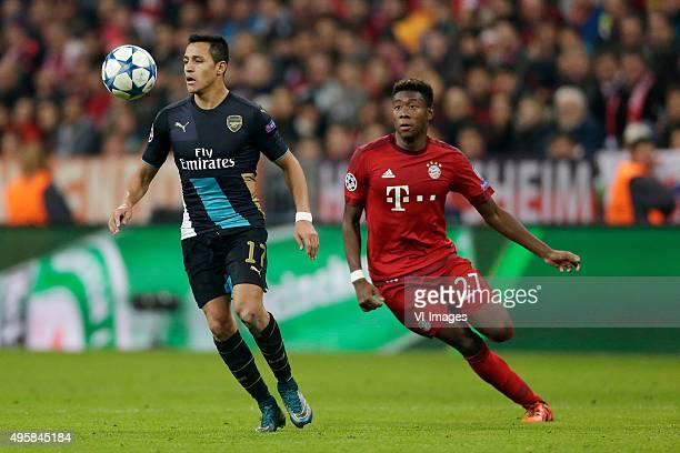 Alexis Sanchez of Arsenal David Alaba of Bayern Munchen during the Champion League group F match between FC Bayern Munich and Arsenal FC on November...