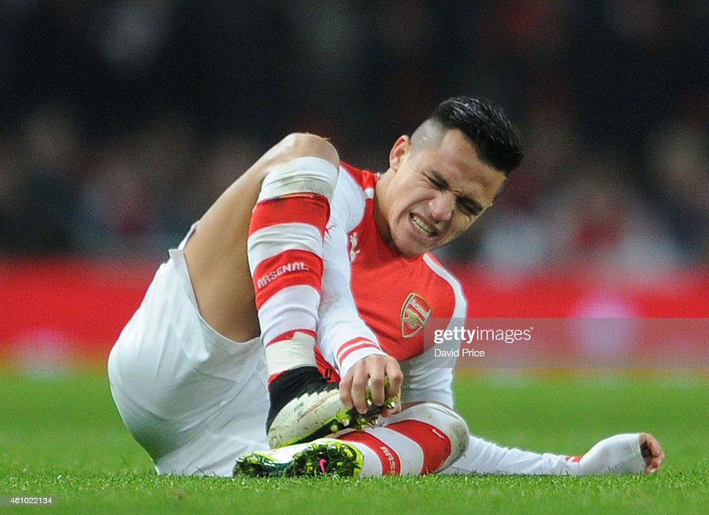 Alexis Sanchez of Arsenal during the match between Arsenal and Hull City in the FA Cup 3rd Round at Emirates Stadium on January 4, 2015 in London, England.