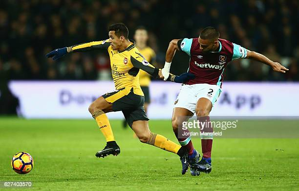 Alexis Sanchez of Arsenal evades Winston Reid of West Ham United during the Premier League match between West Ham United and Arsenal at London...
