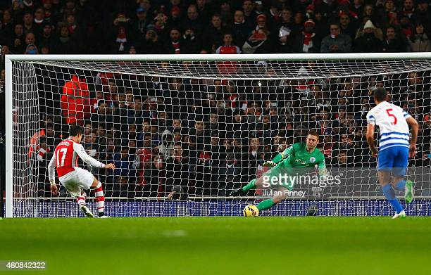 Alexis Sanchez of Arsenal fails to score his penalty saved by Robert Green of QPR during the Barclays Premier League match between Arsenal and Queens...