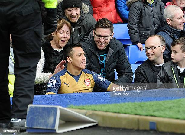 Alexis Sanchez of Arsenal falls into the fans during the Barclays Premier League match between Everton and Arsenal at Goodison Park on March 19 2016...