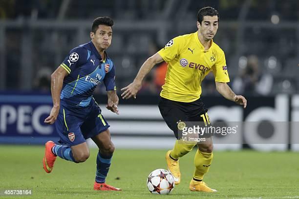 Alexis Sanchez of Arsenal FC Henrikh Mkhitaryan of Borussia Dortmund during the UEFA Champions League group D match between Borussia Dortmund and...