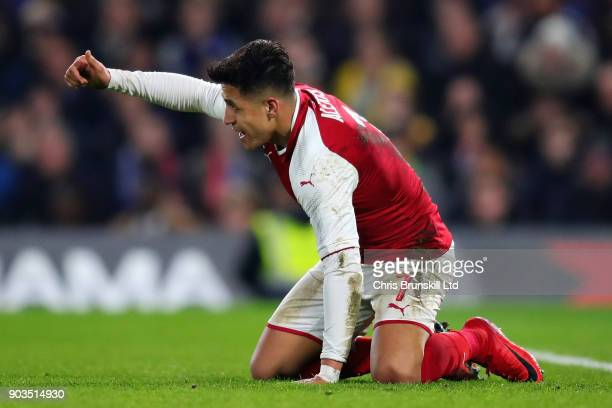 Alexis Sanchez of Arsenal gives a thumbs up during the Carabao Cup SemiFinal First Leg match between Chelsea and Arsenal at Stamford Bridge on...