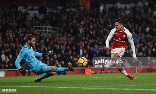 Alexis Sanchez of Arsenal has his shot saved by David De Gea of Man Utd during the Premier League match between Arsenal and Manchester United at...