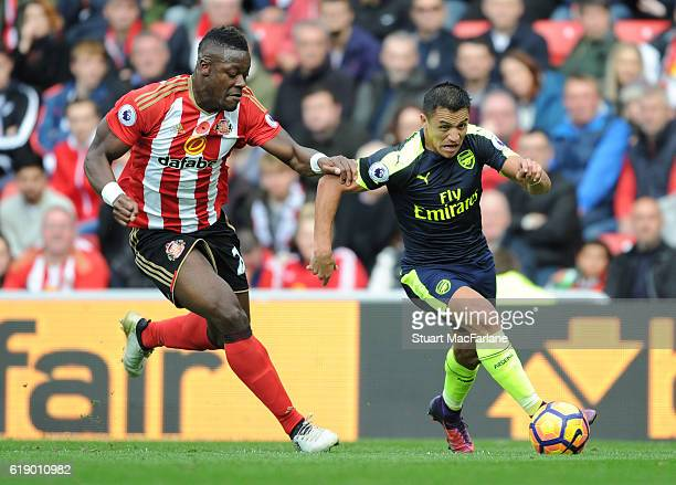 Alexis Sanchez of Arsenal held back by Lamine Kone of Sunderland during the Premier League match between Sunderland and Arsenal at Stadium of Light...