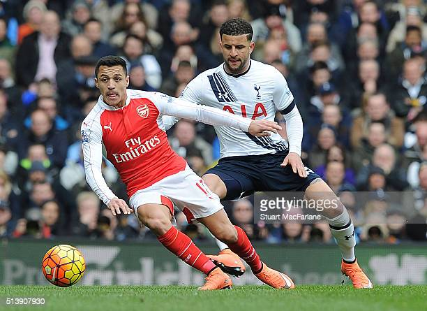 Alexis Sanchez of Arsenal holds off Kyle Walker of Tottenham during the Barclays Premier League match between Tottenham Hotspur and Arsenal at White...