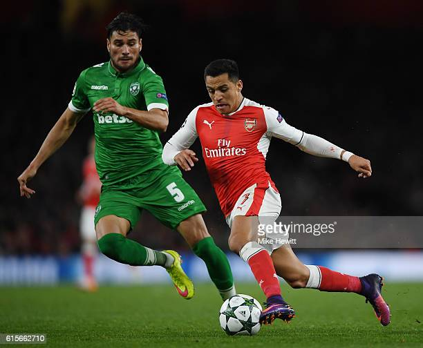 Alexis Sanchez of Arsenal holds off pressure from Jose Luis Palomino of Ludogorets Razgrad during the UEFA Champions League group A match between...