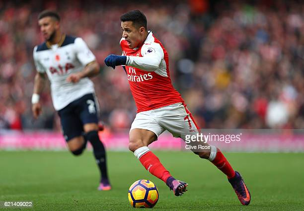 Alexis Sanchez of Arsenal in action during the Premier League match between Arsenal and Tottenham Hotspur at Emirates Stadium on November 6 2016 in...