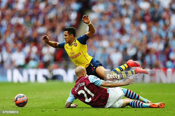 Alexis Sanchez of Arsenal is challenged by Alan Hutton of Aston Villa during the FA Cup Final between Aston Villa and Arsenal at Wembley Stadium on...