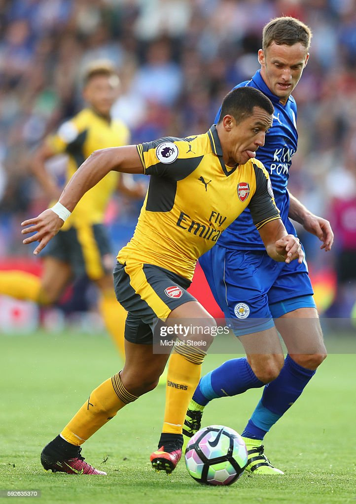 Alexis Sanchez of Arsenal is challenged by Andy King of Leicester during the Premier League match between Leicester City and Arsenal at The King Power Stadium on August 20, 2016 in Leicester, England.