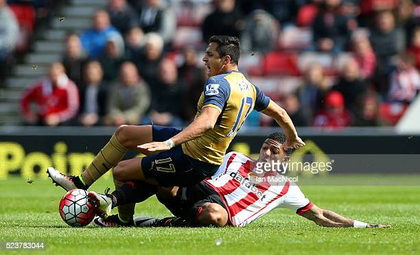 Alexis Sanchez of Arsenal is challenged by Patrick van Aanholt of Sunderland during the Barclays Premier League match between Sunderland and Arsenal...
