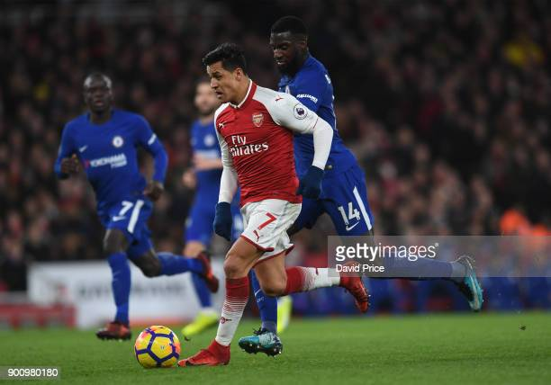 Alexis Sanchez of Arsenal is challenged by Tiemoue Bakayoko of Chelsea during the Premier League match between Arsenal and Chelsea at Emirates...