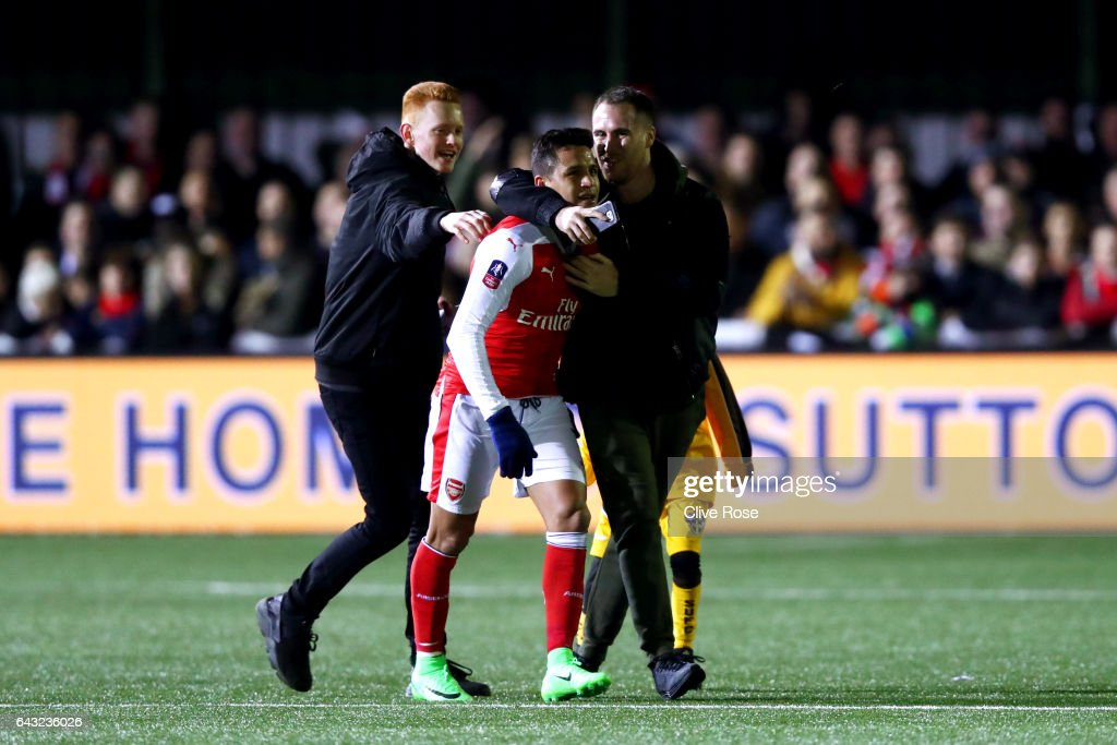 Alexis Sanchez of Arsenal is congratulated by fans on the pitch after the Emirates FA Cup fifth round match between Sutton United and Arsenal on February 20, 2017 in Sutton, Greater London.