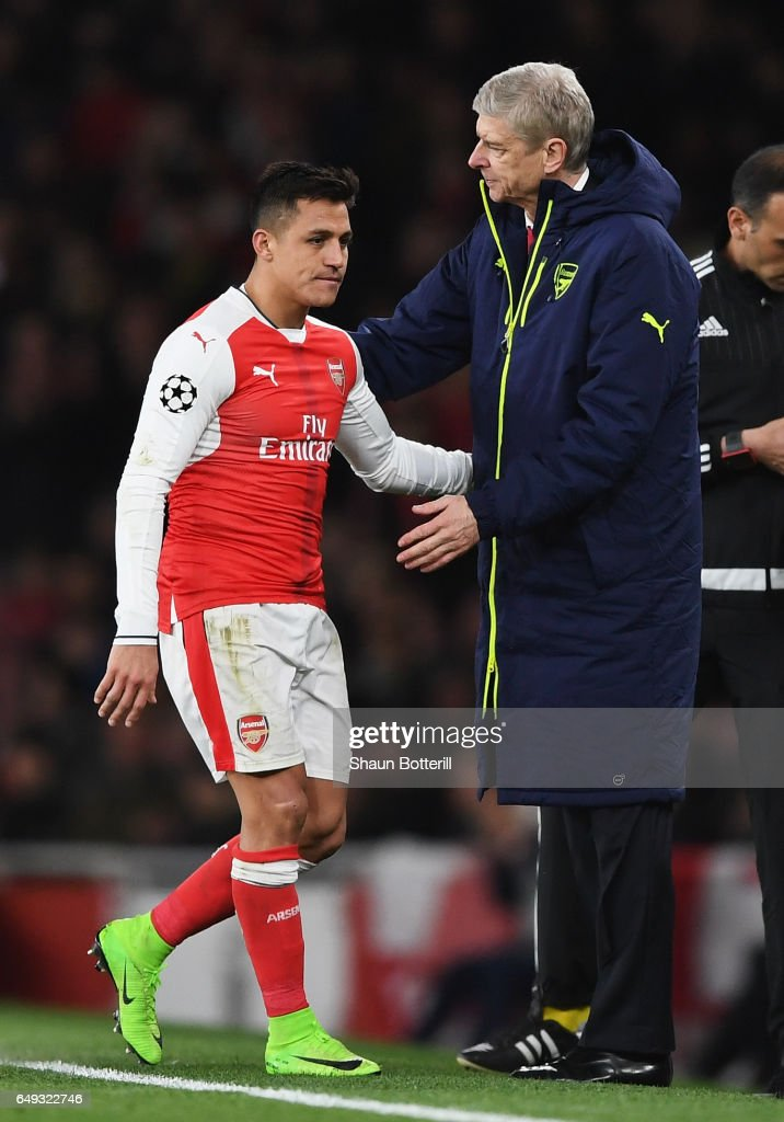 Alexis Sanchez of Arsenal is consoled by Arsene Wenger, Manager of Arsenal as he is substituted during the UEFA Champions League Round of 16 second leg match between Arsenal FC and FC Bayern Muenchen at Emirates Stadium on March 7, 2017 in London, United Kingdom.